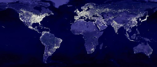 Humanity spread across the world, seen as lights at night.